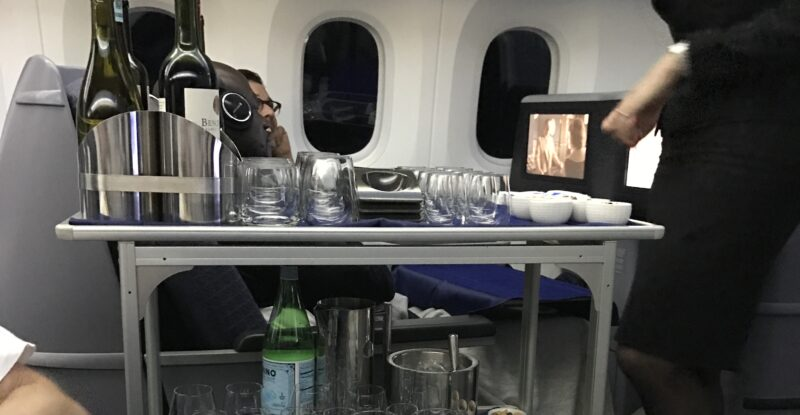 Aircraft trolley with a display of a first course meal