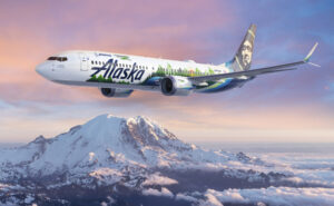 An Alaska Airlines 737-9, shown as a rendering here in-flight, is serving as the flying test lab for Boeing's 2021 ecoDemonstrator program, which will evaluate about 20 technology projects. (Boeing rendering)
