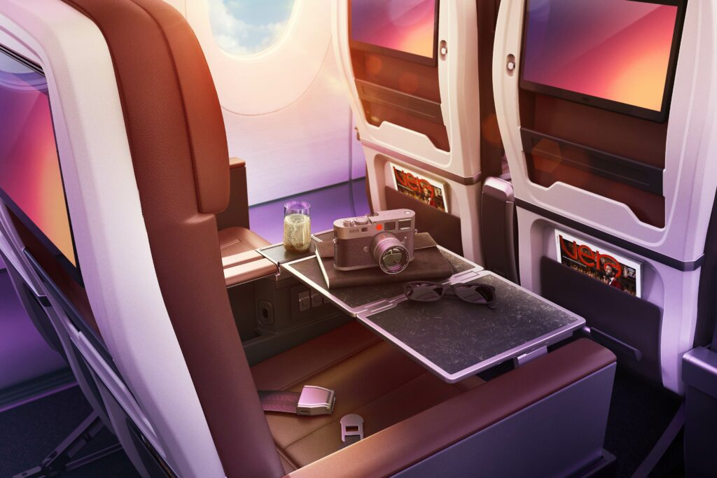 Virgin Atlantic's premium class seat with a tray table set out.