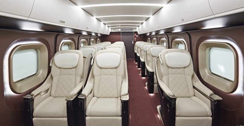 Toyota Boshoku Gran Class seats in a 1-2 configuration. Seats are all white with red carpets.