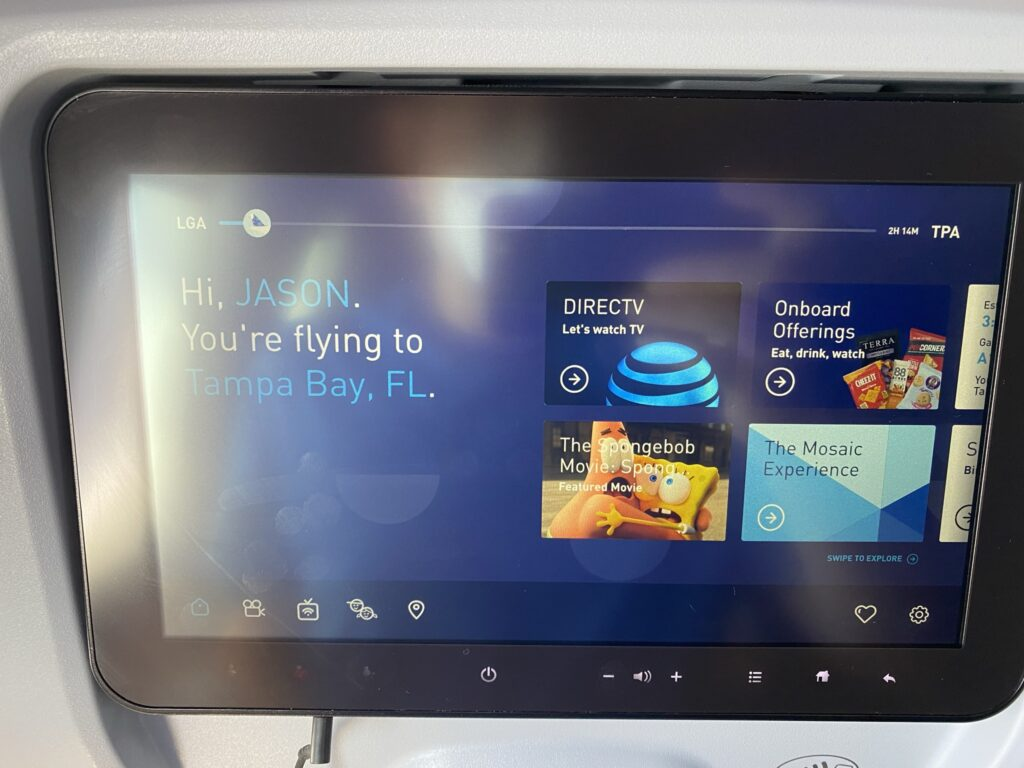 JetBlue's IFE system, showing a selection of DIRECTV, onboard food options, movies and more