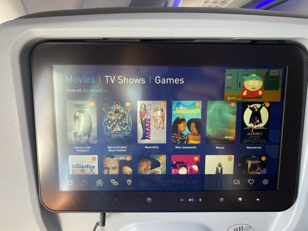 JetBlue seatback IFE system displaying different movie and television options