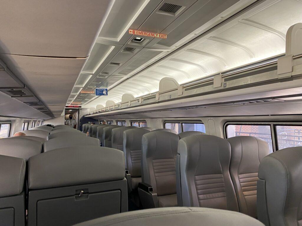 Amtrak rail car interior. Seating is all grey.