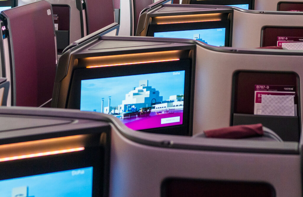 Qatar 787 Adient Ascent seat up close, with the large IFE screen in view