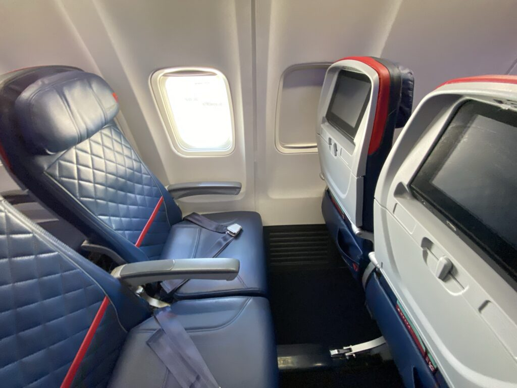 Blue seats and seatback IFE in the Comfort+ section on the Delta 757-200