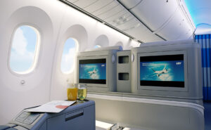LOT business class on the Boeing Dreamliner. Visible is the IFE system and large aircraft windows.