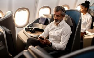 A man uses his device on board