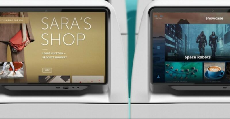 """Thales AVANT UP IFE Monitor. It is displaying the AIRFREE duty free landing page that is titled """"Sara's Shop"""". A second screen is showing a scene from a movie."""