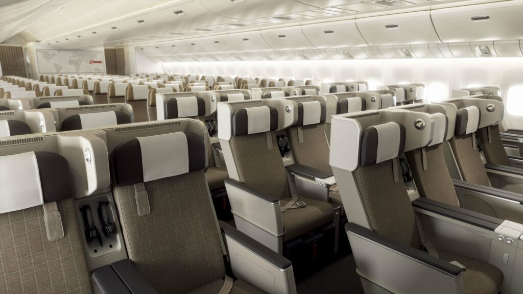 SWISS Premium Economy Class on a 777-300ER aircraft from a front angle view.