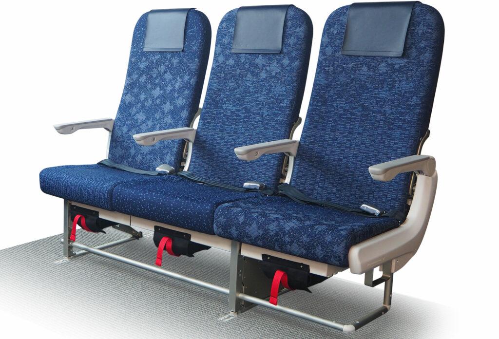 Toyota Boshoku's economy seat on a white back drop. Seats are a blue pattern.