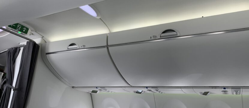 Aircraft interior view of the overhead bins closed.