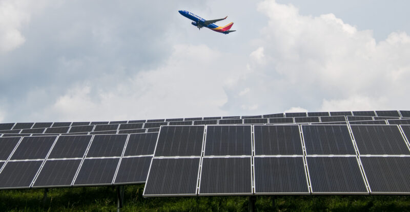 A Southwest 737 flying over PIT Airport's microgrid of solar panels.