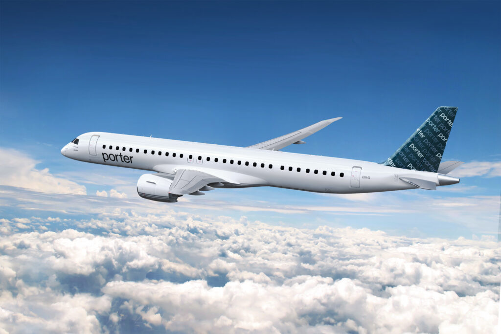 Porter Airlines E195-E2 in flight over clouds.