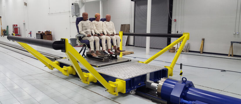 Aircraft seating sled for testing, with 3 crash test dummies in place at Mirus facility