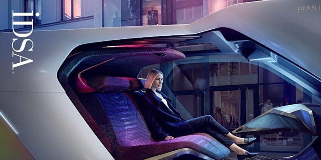 A woman seats in a futuristic vehicle