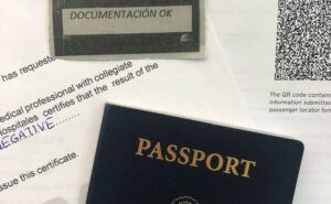 Papers for travel. Passport and negative COVID test results. Europe US