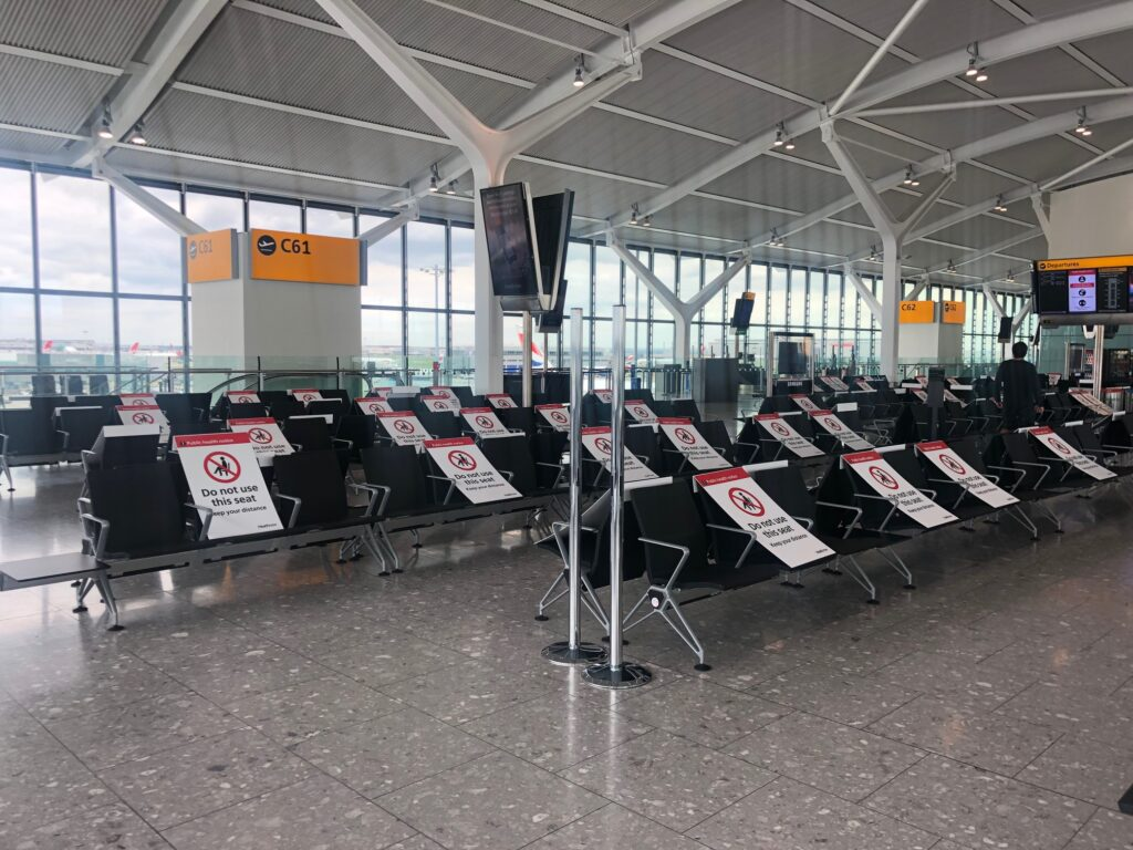 Airport with seats blocked off for COVID distancing