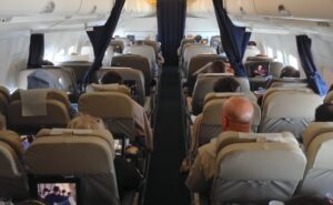 Curtains serve as a class divider on board this narrowbody aircraft
