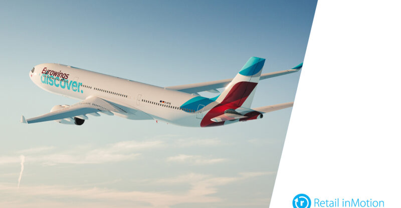 Eurowings Discover aircraft in-flight with a Retail inMotion logo on the bottom right.