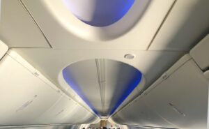 Boeing Sky Interior of 737NG with bright blue LED lights and a decorative overhead