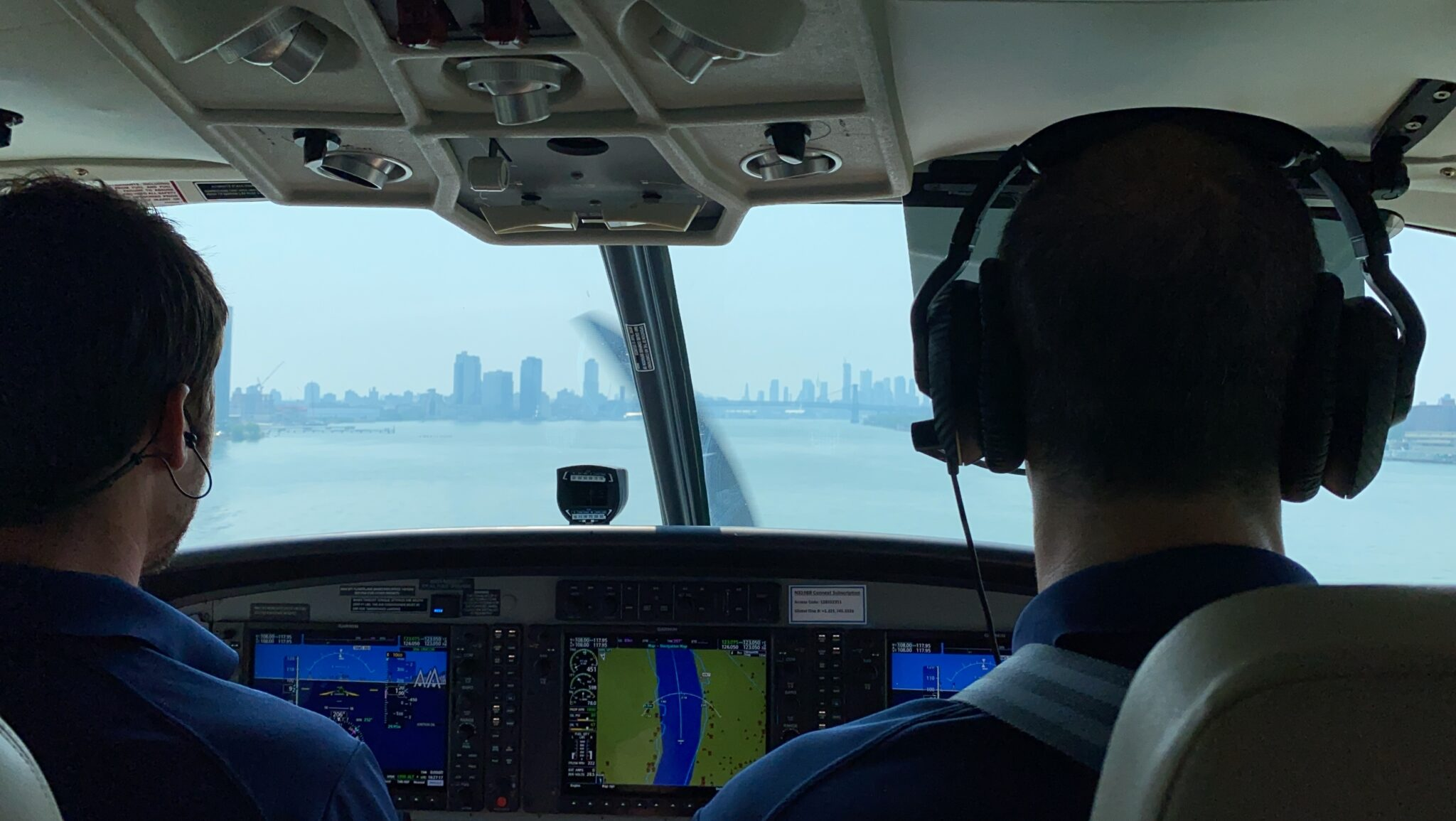 Tailwind seaplane's cockpit, with two pilots at the controls