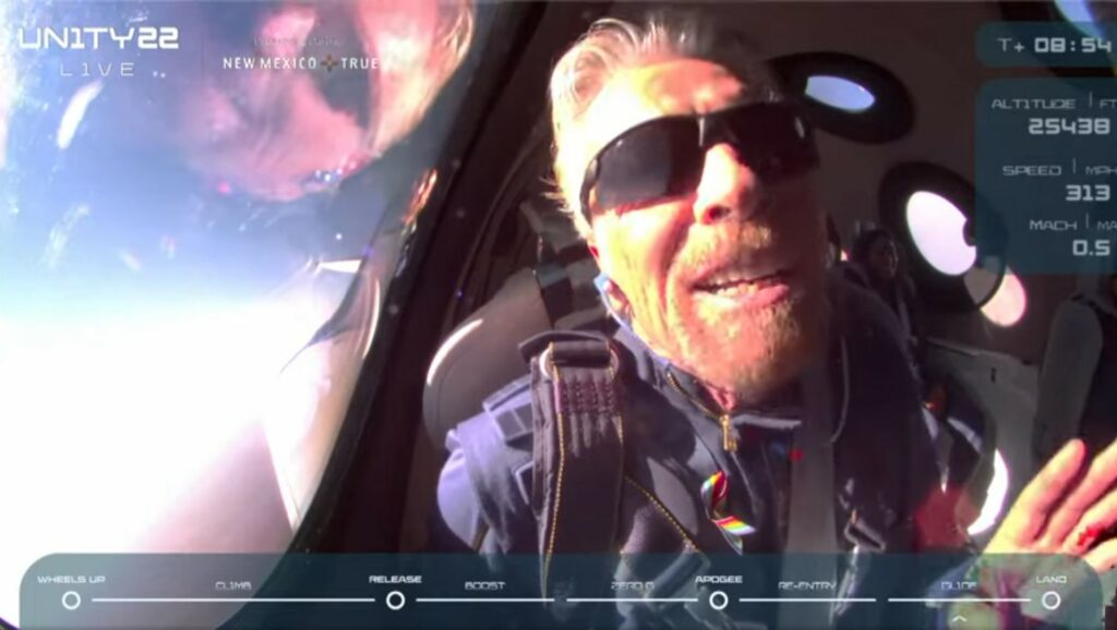 Richard Branson talking to cameras as he has just entered space.