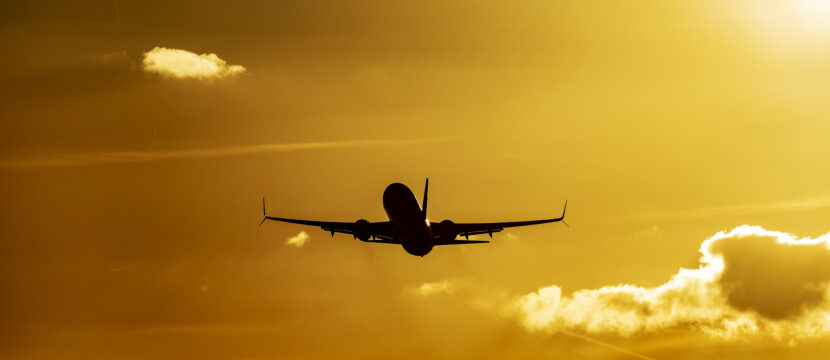 A 737 flies into the sunset.