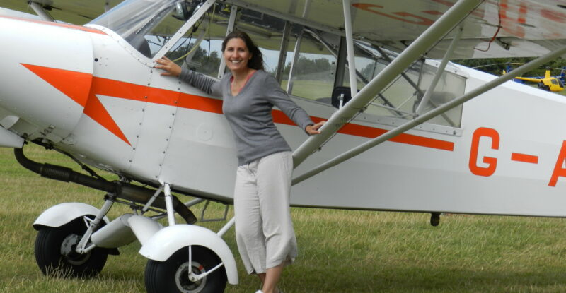 Susan Tuddenham is a Citation 560XLS first officer but has a passion for vintage aviation. Here she is with a Piper Super Cub glider tug. Image: Susan Tuddenham