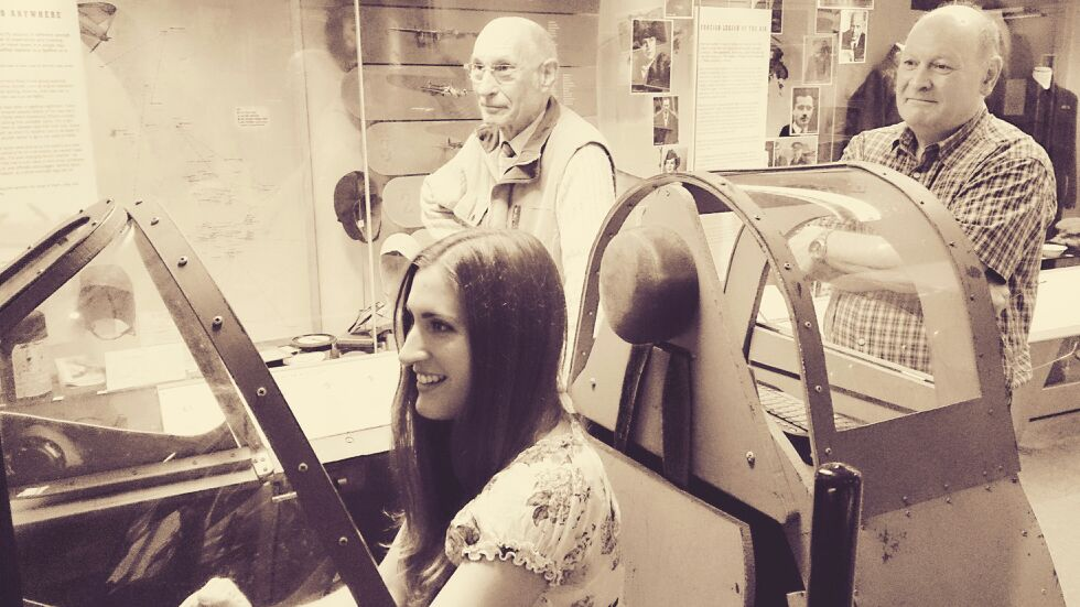 Trying the Spitfire simulator at the Air Transport Auxiliary Museum & Archive in Maidenhead, UK, with dad looking on. Image: Susan Tuddenham