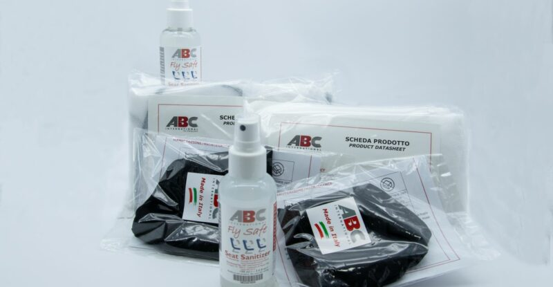 ABC International products. Masks and sanitizer spray are displayed.