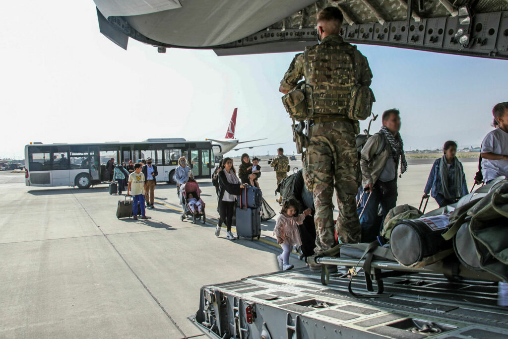 Image of British citizens and dual nationals residing in Afghanistan being relocated to the U.K. As part of Operation PITTING, the UK Armed Forces are enabling the relocation of personnel and others from Afghanistan.