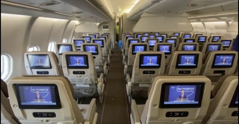 China Eastern aircraft interior. View from the back of all the embedded IFE.