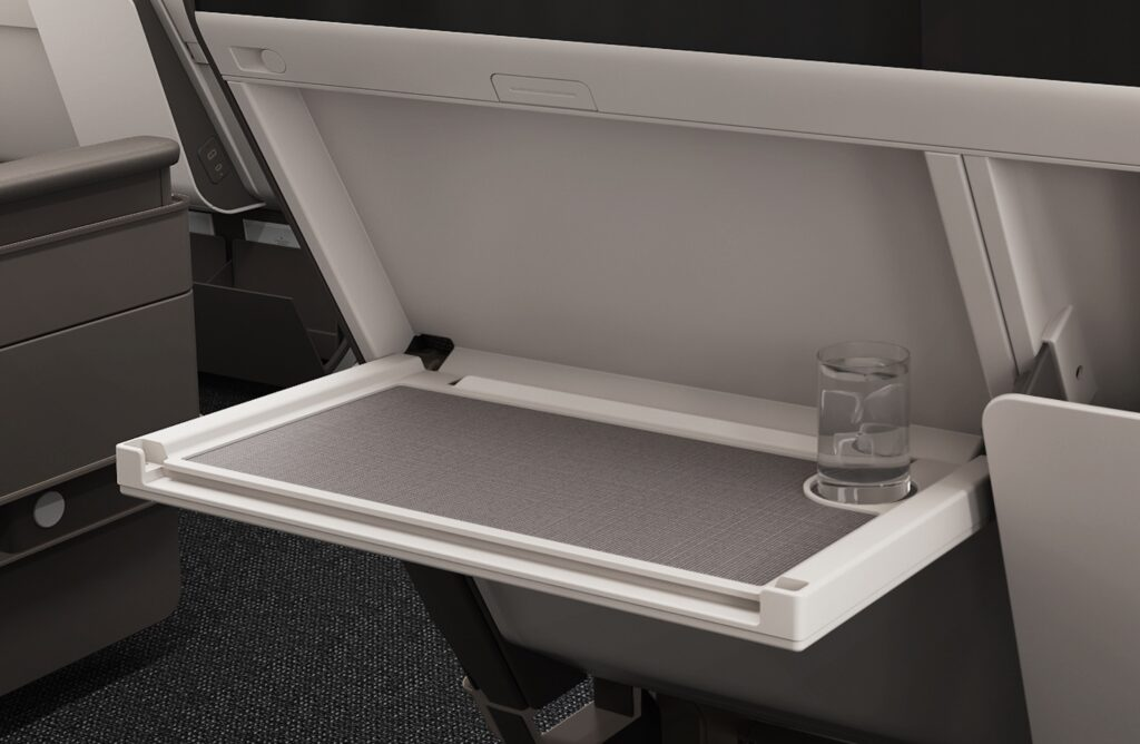 Cathay Pacific's economy class seat with a close up of the tray table.