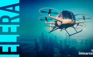 The word ELERA runs up the side of the image. The image is a UAV over a blurred city view.