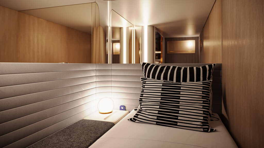 Midnight Trains' solo room displayed with soft lighting and large pillows on a bed.