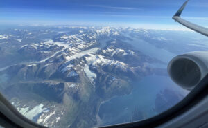 Looking out the window of Alaska Airlines 737-900 over snowy mountains of Anchorage