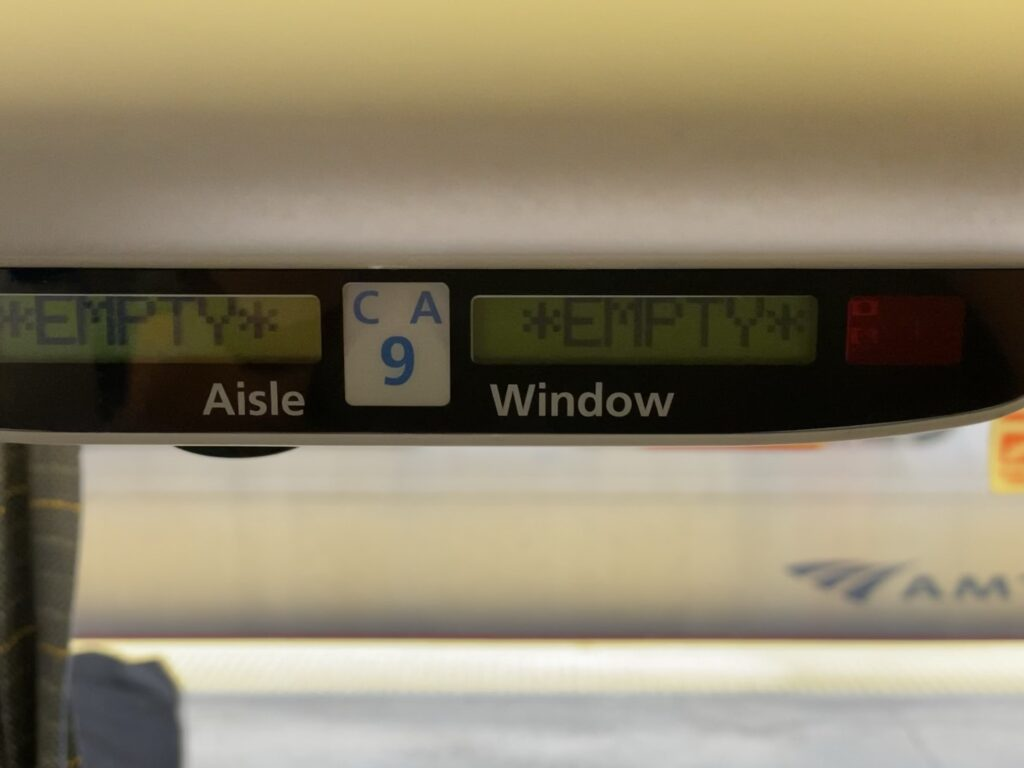 Seat display that reads the seat is empty on an Amtrak car.