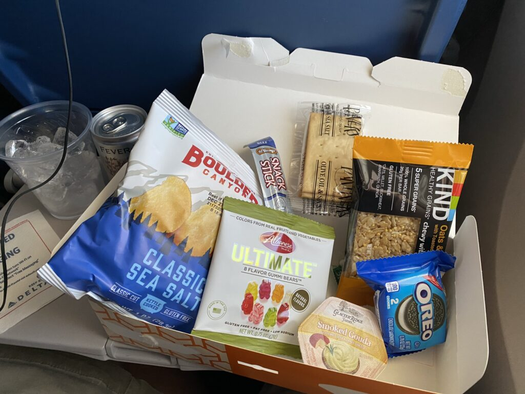 An assortment of snacks and treats in Delta's snack box