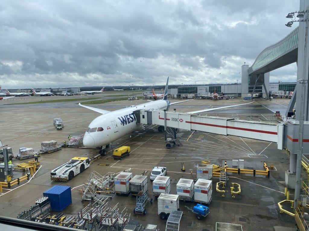 WestJet Boeing 787-9 at the gate for boarding.