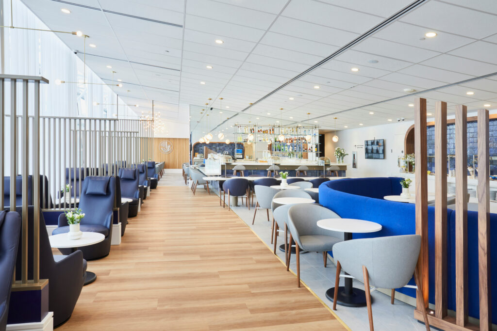 A variety of seats are in view, including comfy blue reclines, and the u-shaped sofa bench