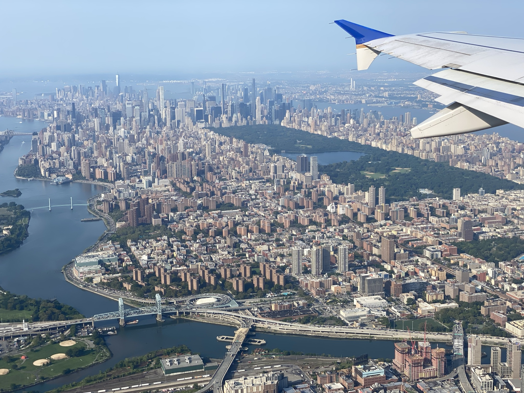 United Airlines' A320 wing, a view out the window flying over New York