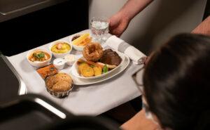 British Airways roast beef dinner being served to a passenger inflight.