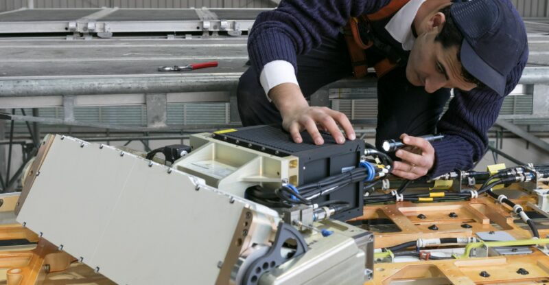 a man working on an aircraft IFC installation as LHT has received Chinese STC validation
