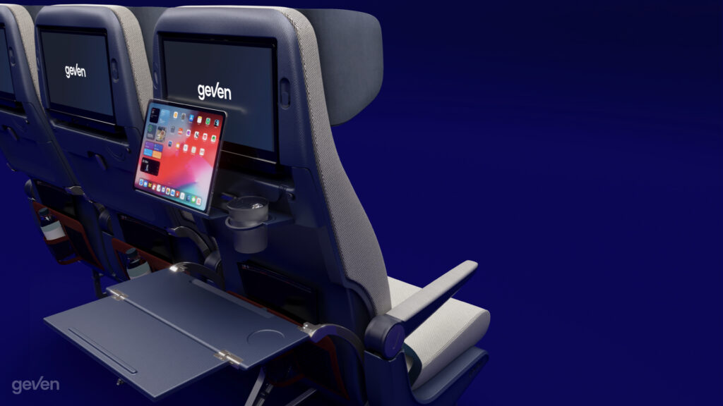 Tray table and PED holder for the Elemento Economy class seat by Geven rendered on a blue background.