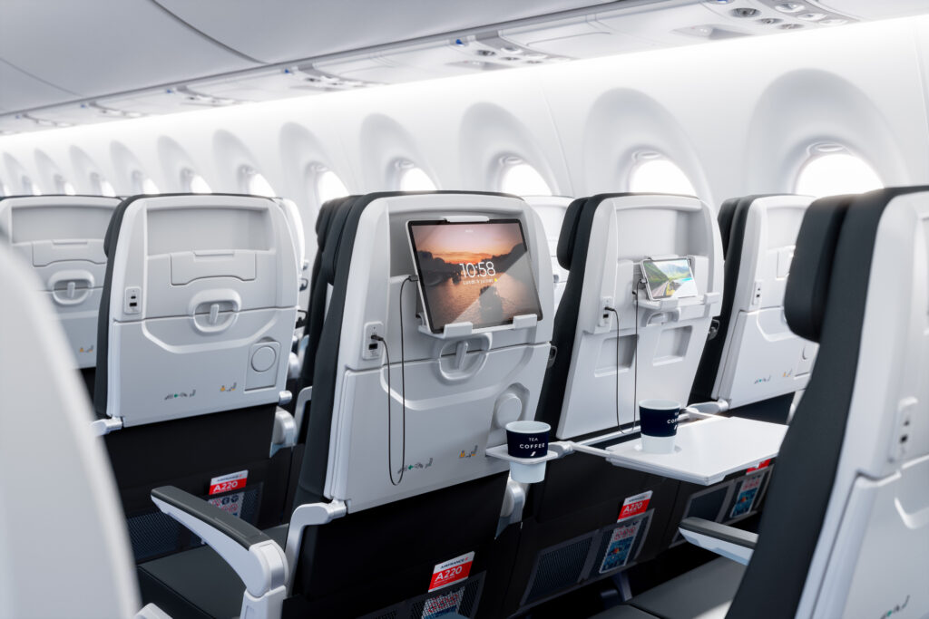 Air France A220-300 cabin interior. This is a view of the seatback. There is PED in the provided holder, plugged into the inseat USB power port.