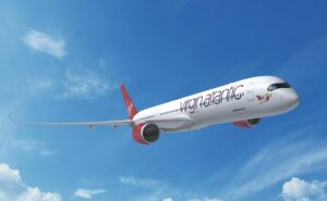 A350-1000 with Virgin Atlantic livery flying in a clear blue sky