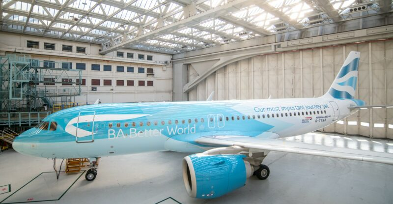 BA Better World Livery on an Airbus A320neo aircraft parked in a hanger.