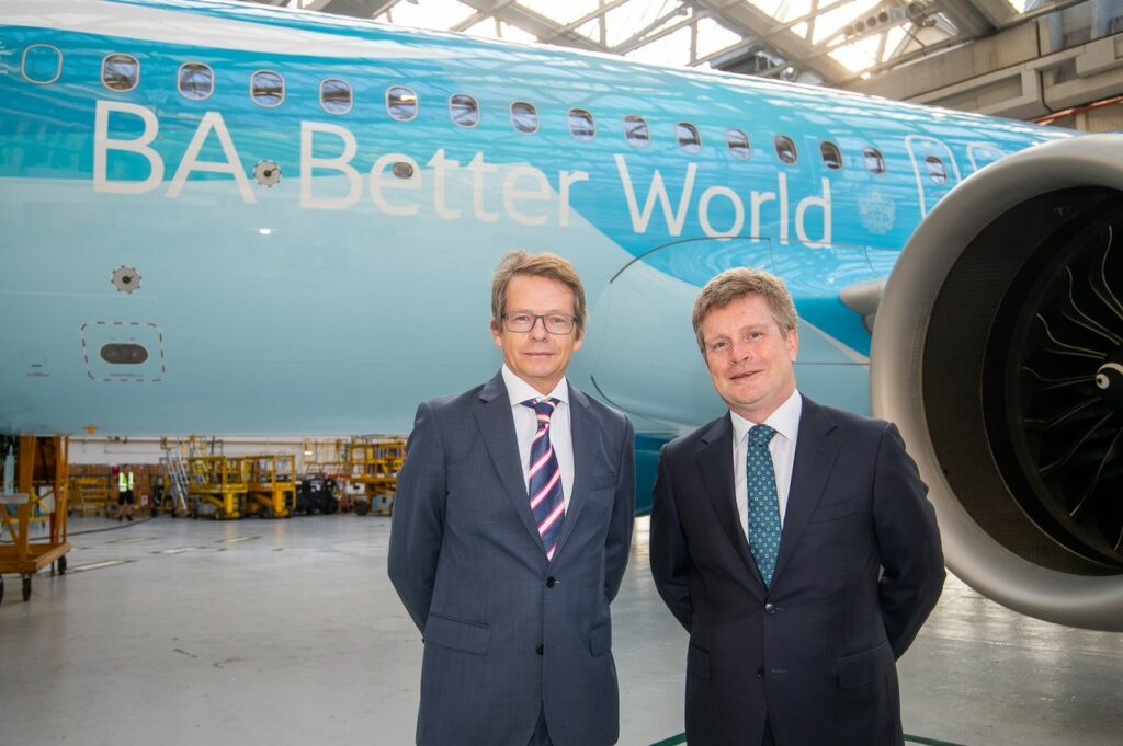 Two BA executives standing in front of the aircraft with the new livery for BA Better World.