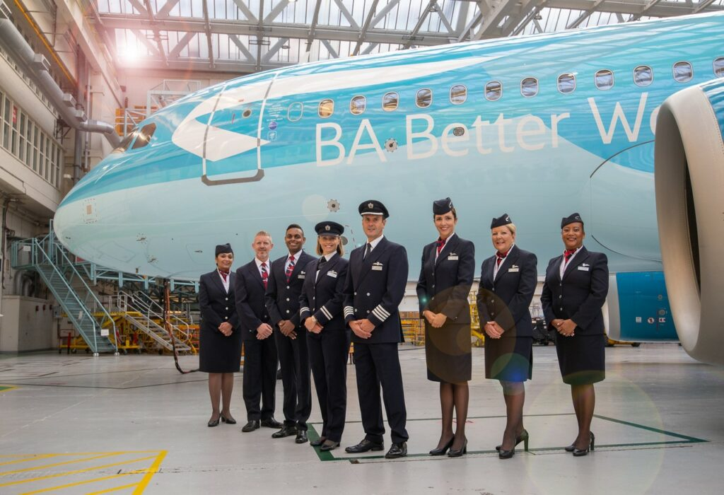 BA Crew standing in a pyramid formation in front of the aircraft with the new livery for BA Better World