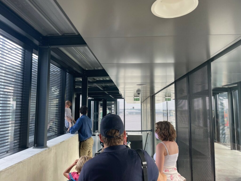 Passengers waiting to board a British Airways aircraft on the jet bridge